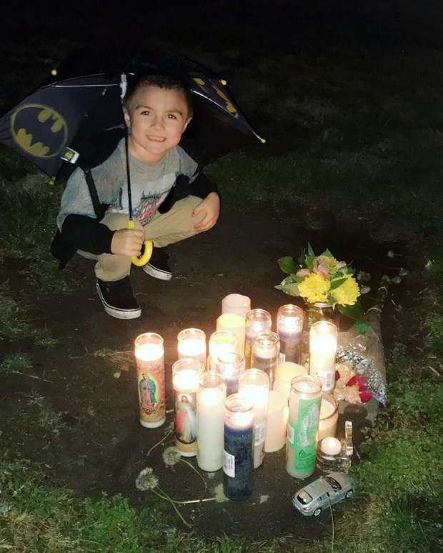 Noah Winstead, 4, visits the site where his father, 25-year-old Robert Winstead, was killed in a crash in Fontana. (Courtesy Piper Family)