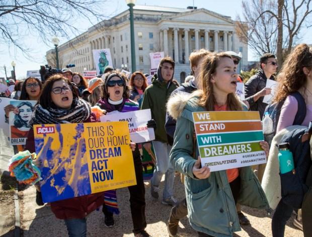 Deferred Action for Childhood Arrivals (DACA) recipients and other young immigrants march with supporters as they arrive at the Capitol in Washington, Monday, March 5, 2018. The program that temporarily shields hundreds of thousands of young people from deportation was scheduled to end Monday by order of President Donald Trump but court orders have forced the Trump administration to keep issuing renewals. (AP Photo/J. Scott Applewhite)