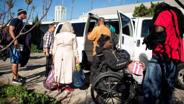 People get on a shuttle at the Hope of the Valley Rescue Mission Help Center in Van Nuys. The shuttle takes people in need to an emergency shelter in Pacoima. (Photo by Hans Gutknecht, Los Angeles Daily News/SCNG)