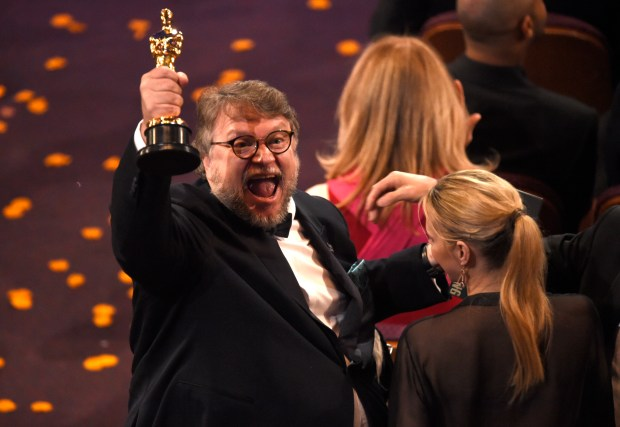 "Guillermo del Toro, winner of the award for best director for ""The Shape of Water"" celebrates in the audience at the Oscars on Sunday, March 4, 2018, at the Dolby Theatre in Los Angeles. (Photo by Chris Pizzello/Invision/AP)"