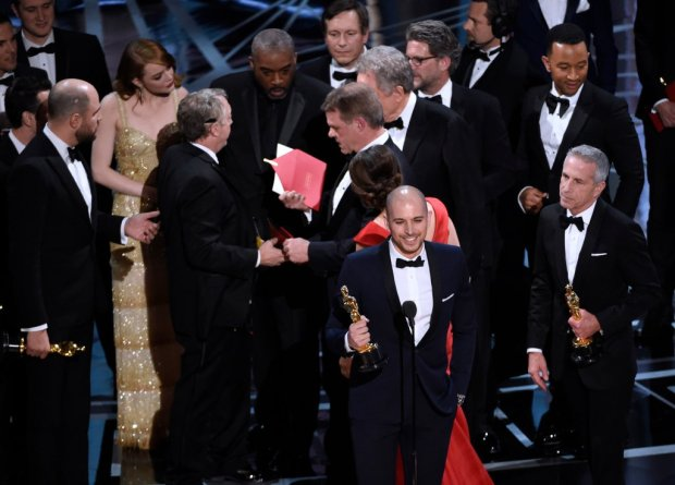 "Fred Berger, foreground center, and the cast of ""La La Land"" mistakenly accept the award for best picture at the Oscars on Sunday, Feb. 26, 2017, at the Dolby Theatre in Los Angeles. The actual winner of best picture went to ""Moonlight."" (Photo by Chris Pizzello/Invision/AP)"