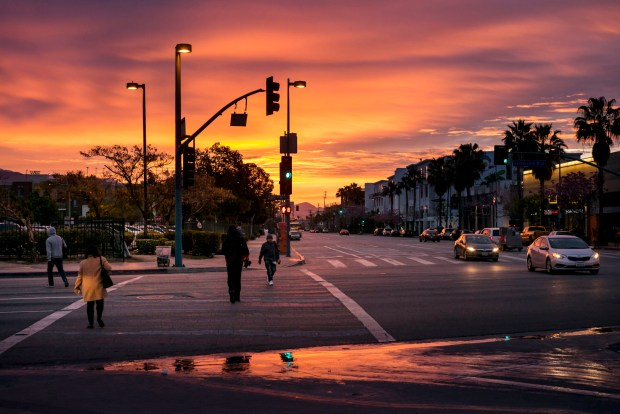 "The old saying, ""Red sky in the morning, sailors take warning,"" may hold true as a red sky dawns at the intersection of Chandler and Lankershim boulevards in the NoHo Arts District early Tuesday, March 20, 2018, with the biggest storm of the season forecast to be bearing down on Southern California. (Photo by David Crane, Los Angeles Daily News/SCNG)"