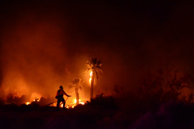 A firefighter on scene during the Oasis of Mara fire March 26. (Steve Raines/Courtesy National Park Service)