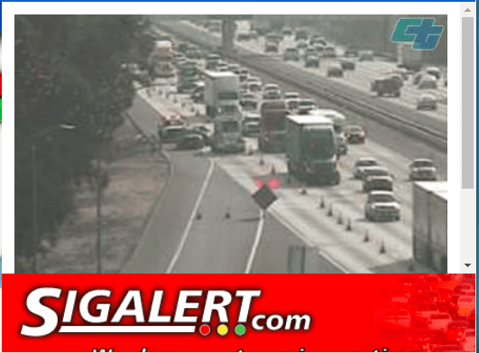 A traffic camera near the Pepper Avenue offramp from the westbound 10 Freeway show the traffic along the freeway following a fatal crash between a school bus and a Jeep. No students were on board the bus. The driver of the Jeep later died. (SigAlert.com)