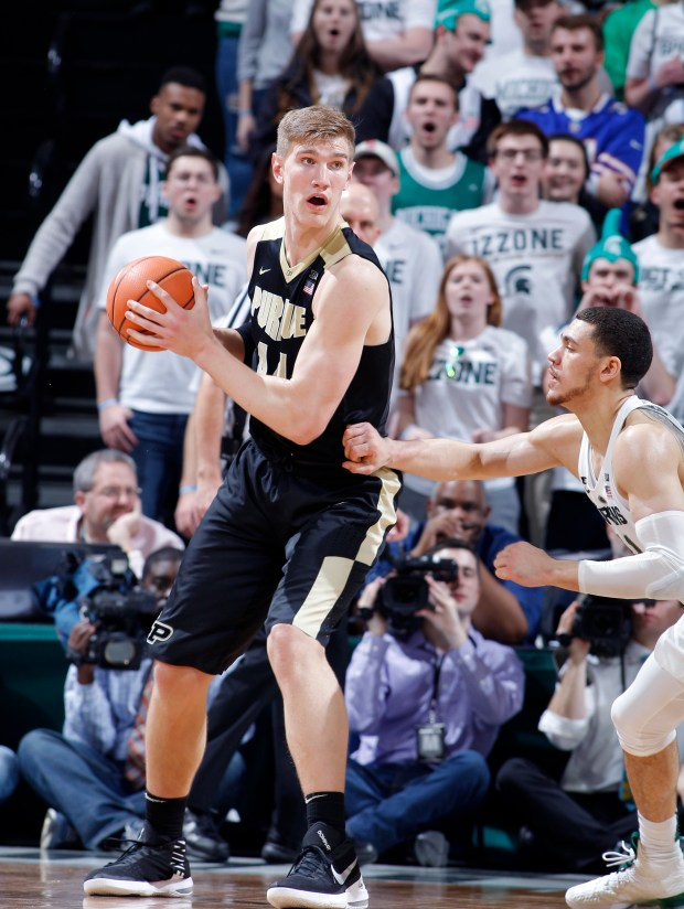 Purdue's Isaac Haas, left, maneuvers against Michigan State's Gavin Schilling during an NCAA college basketball game, Saturday, Feb. 10, 2018, in East Lansing, Mich. (AP Photo/Al Goldis)