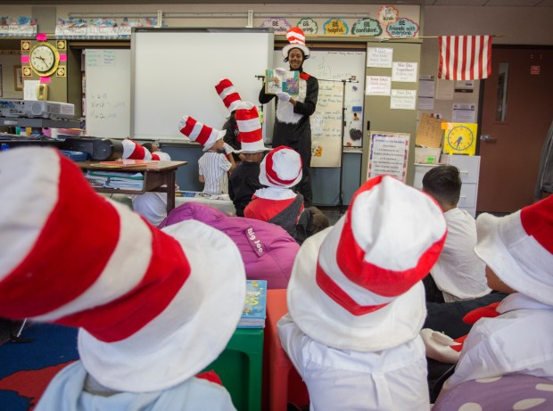 """Substitute teacher David Royster, dressed as the Cat in the Hat, reads from """"There's a Wocket in my Pocket!"""" to second-graders at Bear Valley Elementary School in Moreno Valley on Friday, March 2.Photo by Andrew Foulk, contributing photographer"""