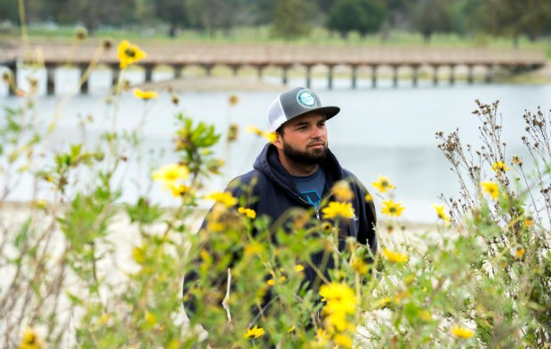 Eric Zahn, a restoration ecologist who works for a consulting firm called Tidal Influence, stands among the blooming native wildflowers at the Colorado Lagoon Wetland and Marine Science Education Center in Long Beach on Wednesday, April 4, 2018. ( Photo by Thomas R. Cordova/Daily Breeze)