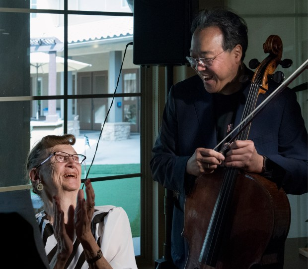 After cellist Yo-Yo Ma performed a special show for the 13 siblings whose parents are accused of abusing them in their Perris home, he went on to play at Valencia Terrace Friday, Mar. 2, where he had an impromptu duet with resident Marjorie Keith. (Photo by Cindy Yamanaka, The Press-Enterprise/SCNG)