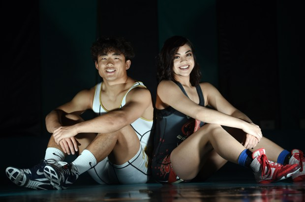 Corona SantiagoÕs Josh Kim (left), 18 and CoronaÕs Caitlin Cardenas (right), 17, have both been selected as the HSGameTime Wrestlers of the Year. (Photo by Will Lester, Inland Valley Daily Bulletin/SCNG)