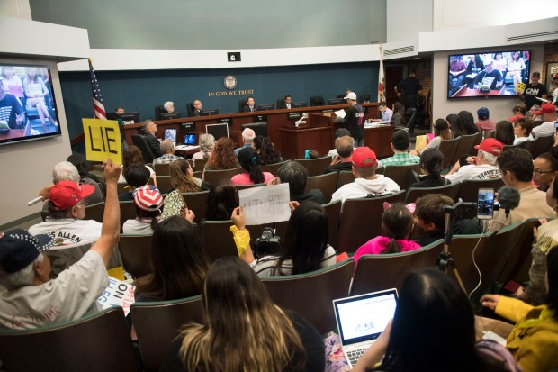 People pack the Westminster City Council Chamber during public comments regarding SB 54, the California Values Act, otherwise known as the California sanctuary state law, in Westminster on Wednesday, April 11, 2018. (Photo by Kevin Sullivan/Orange County Register/SCNG)