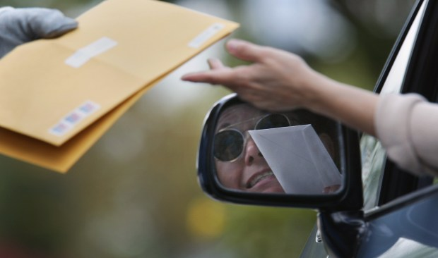 Four area postal processing centers will stay open until midnight Tuesday, April 17, so tax filers can get their envelopes out on time. (Michael Goulding / Orange County Register