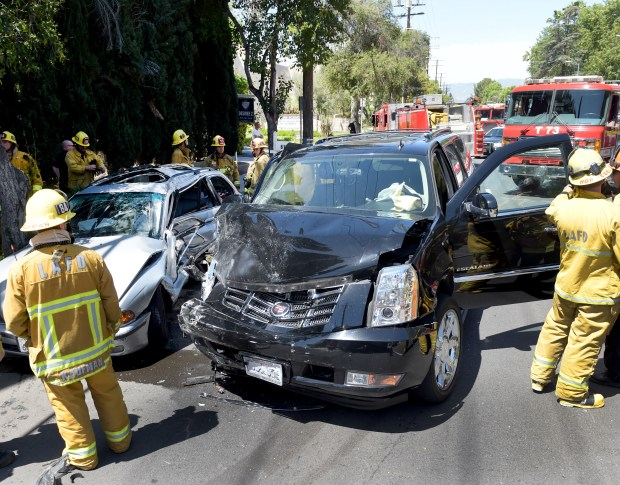 A traffic collision between a Cadallic SUV and a BMW compact occured in the 6100 block of Shoup Ave. in Woodland Hills on Wednesday, April 18, 2018. (Photo by Dean Musgrove, Los Angeles Daily News/SCNG)
