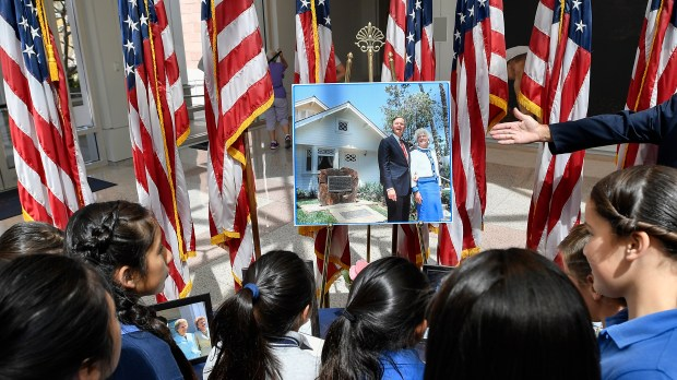 Students from St. John the Baptist in Costa Mesa, examine a Barbara Bush memorial during a tour of the Richard Nixon Library in Yorba Linda on Wednesday, Apr 18, 2018. The library will have the book on display until April 30, then it will be sent to the Bush family. The public is invited to sign the book, no admission to the library is necessary. (Photo by Jeff Gritchen, Orange County Register/SCNG)