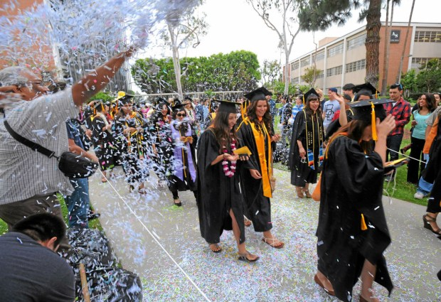 The California State University system announced Friday, April 20, 2018, that it wouldn't raise tuition this year. The system's chancellor said that degree completion is among the colleges' focus. (File photo of a CSULB graduation in 2013 by Scott Varley/Long Beach Press-Telegram)