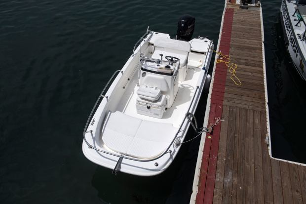 A 17-foot Boston Whaler is docked in Newport Beach Harbor on Monday, April 23, 2018. The boat washed ashore the previous day and a search is underway for Nicholas Busick. (Photo by Paul Bersebach, Orange County Register/SCNG)