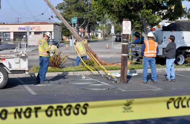 Southern California Edison crews are on scene at the corner of Cherry Avenue and Market Street in Long Beach repairing power poles after a motorist struck several of them after 2a.m. The driver was taken to a local hospital. Long Beach April 25, 2018. Photo by Brittany Murray, Press Telegram/SCNG
