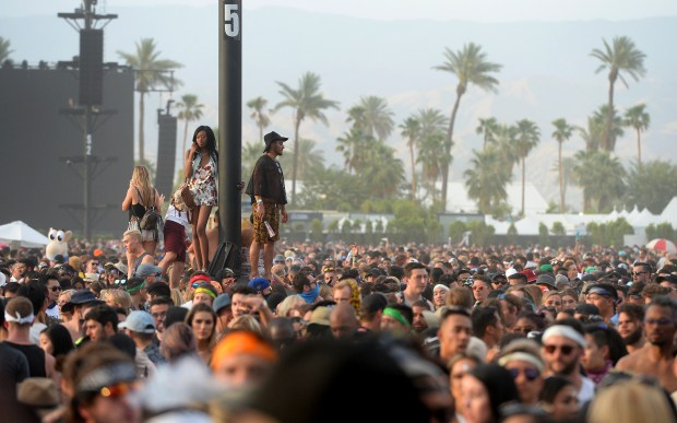 Festival goers make their way across the field after Cardi B's set at the Coachella Stage during the Coachella Valley Music and Arts Festival at the Empire Polo Club in Indio, CA., Sunday, April 15, 2018. (Staff photo by Jennifer Cappuccio Maher, The Press-Enterprise/SCNG)