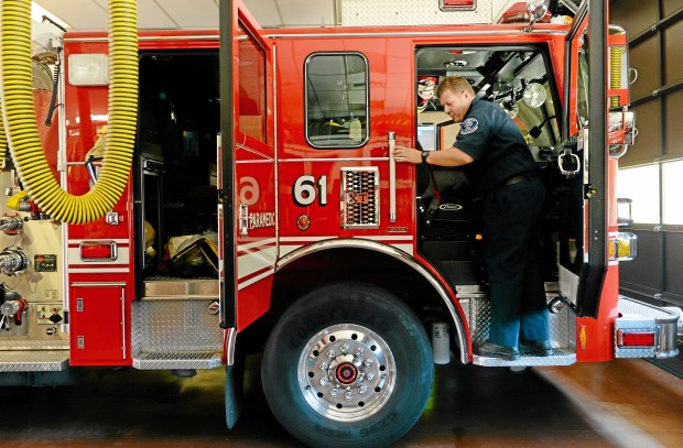 Captain Kevin Greenway, of the La Verne Fire Department, gathers his fire gear for the day at the La Verne Fire Station in La Verne, CA, Tuesday, October 1, 2013.(Jennifer Cappuccio Maher/Inland Valley Daily Bulletin)