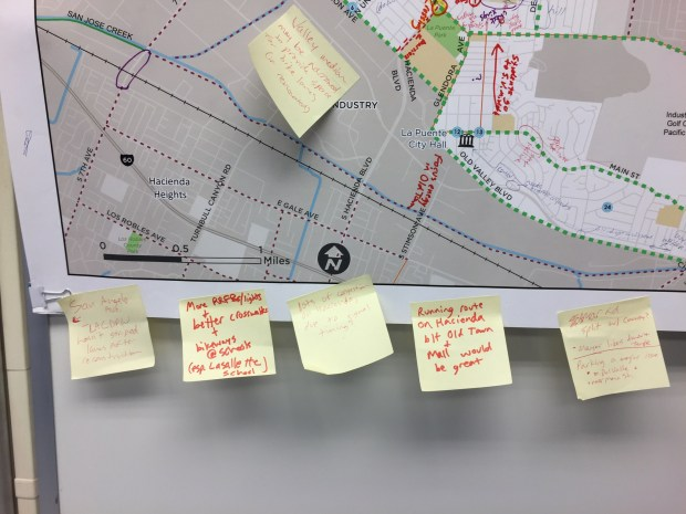 Open house visitors place sticky notes detailing changes they'd like to see incorporated into the La Puente bicycle and pedestrian plan.. The plans were on display at the Bike SGV headquarters on Wednesday, April 25, 2018. (Photo by Steve Scauzillo).