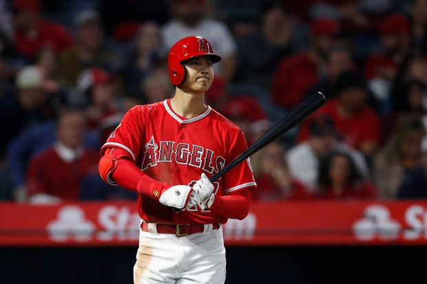 Los Angeles Angels starting pitcher Shohei Ohtani, of Japan, gets ready to bat during the fifth inning of a baseball game against the Cleveland Indians, Tuesday, April 3, 2018, in Anaheim, Calif. (AP Photo/Jae C. Hong)