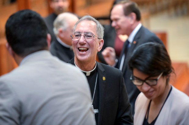 Pope Francis today named Msgr. Marc Trudeau, left, the new Auxiliary Bishop of the Archdicoese of Los Angeles. Trudeau greets family and friends after a press conference at the Cathedral of Our Lady of Angels in downtown Los Angeles Thursday. ( Photo by David Crane, Los Angeles Daily News/SCNG)
