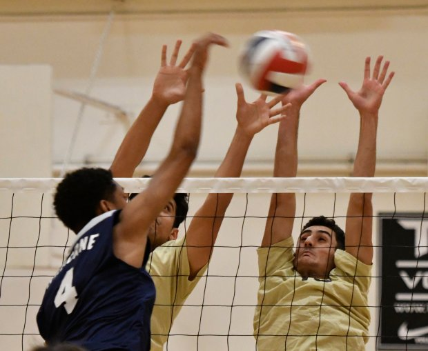 (L) Chatsworth's #4-Khari Obsorne spikes the ball cover the net, as they take on Taft during the City Section boys volleyball West Valley League showdown. Photo by Gene Blevins/LA DailyNews/SCNG