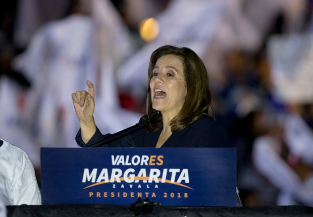 Former first lady and independent presidential candidate Margarita Zavala addresses supporters during a rally at the start of her electoral campaign in Mexico City, early Friday, March 30, 2018. Mexico will hold general elections on July 1. (AP Photo/Eduardo Verdugo)