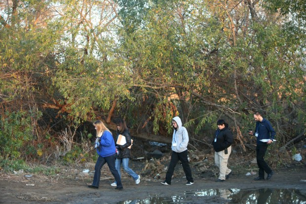 A group led by Susan Von Zabern, director of the county Department of Public Social Services, looks for homeless people living along a creek bed near Van Buren Boulevard in Jurupa Valley on Tuesday, Jan. 23, 2018. (File photo by Stan Lim, The Press-Enterprise/SCNG)