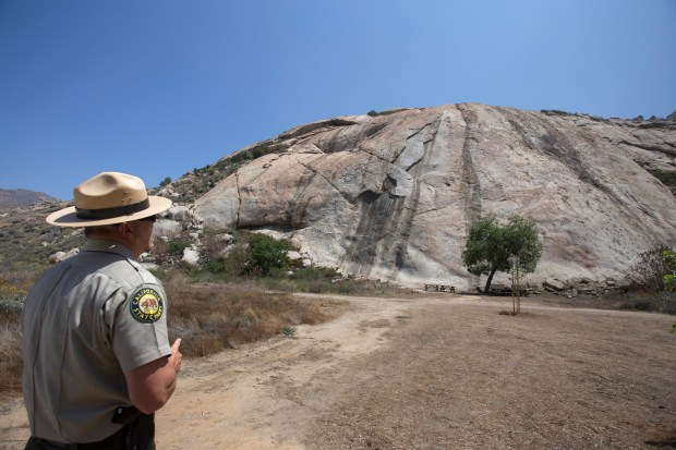 John Rowe, state park superintendent for the Perris Sector, looks up at the rock wall that is now open again for climbing at the Lake Perris State Recreation Area on Friday, April 27.Photo by Andrew Foulk, contributing photographer