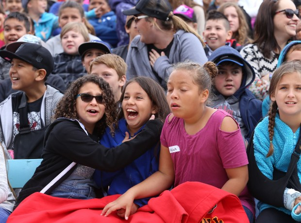 """Fourth-graders from across the region react as actors shoot a cannon Thursday, April 19, during a performance of """"Ramona"""" in Hemet. Photo by Frank Bellino, contributing photographer"""