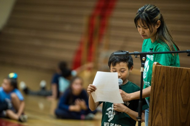 Jonie Domantay helps her 7-year-old son Lucas as he reads in both English and Spanish the benefits of Mountain View Elementary's biliterate program as Azusa Unified Surplus Property Committee decides on closing schools on Friday, April 27, 2018 at Gladstone High School in Covina. (Photo by Sarah Reingewirtz, Pasadena Star-News/SCNG)