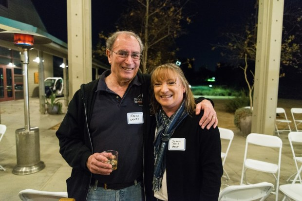 Susan Herb Best, CSUF Class of 1987, gets a warm greeting from one of her former professors, Roger Nanes, professor emeritus of physics, at a recent reunion of physics alumni and faculty of Cal State Fullerton.Photo courtesy Susan Herb Best