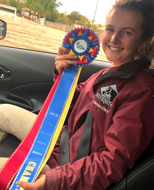 Riverside resident Elle Martin shows the blue ribbon she won in September at Stanford University's Red Barn. She won the High School Champion Rider award for the weekend event.Photo courtesy of Nicol Martin