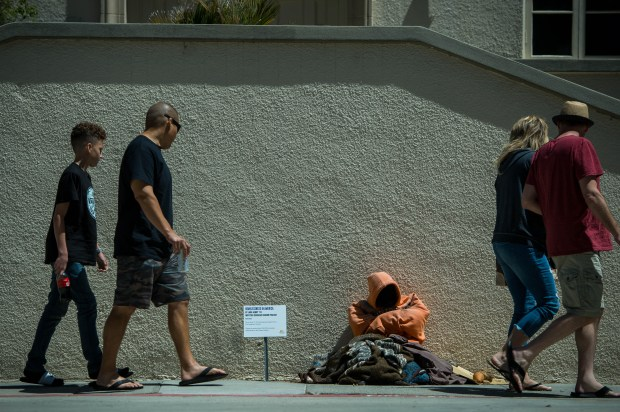 "People walk past Jada Henry's first public art project, Homeless in America, a Whittier Scholars Senior Project, at Whittier College, on Monday, April 16, 2018. ""We walk past homeless people like they're invisible and I want them to be visible,"" says Henry who wants to raise awareness through art. (Photo by Sarah Reingewirtz, Pasadena Star-News/SCNG)"