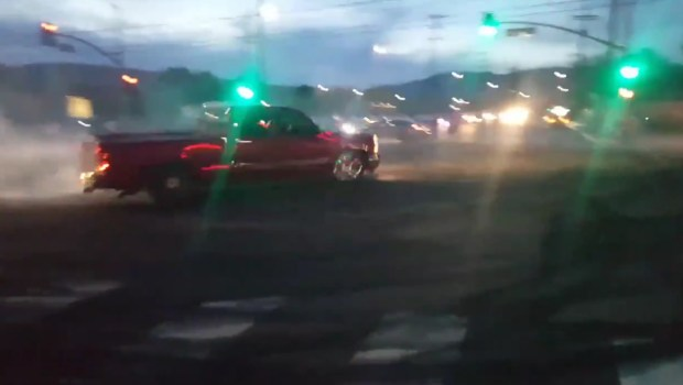 A pickup truck does doughnuts at Plummer Street and Mason Avenue after a group of people illegally closed the intersection on Saturday, May 5, 2018. (Image from Twitter video)