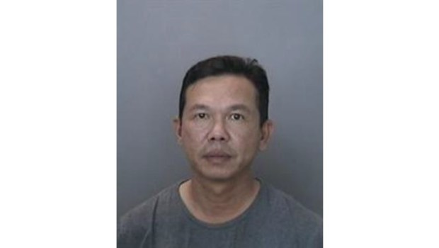 Kelven Ta, 47, was arrested Thursday on suspicion of a hit and run the prior weekend in Anaheim after a member of the public identified his car and alerted authorities, police said. (Courtesy of the Anaheim Police Department)