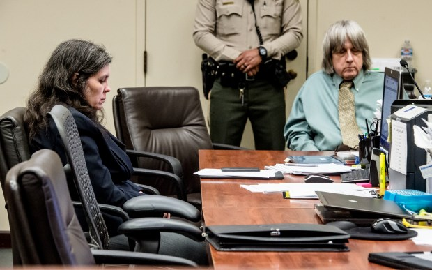 Louise Turpin, left, and husband, David, accused of neglecting and shackling their 13 children, during an appearance at the Riverside Hall of Justice in Riverside, Calif. on Friday, May 4, 2018. David Turpin did not enter a plea to the eight counts of perjury filed for the torture case. (Photo by Watchara Phomicinda, The Press-Enterprise/SCNG)