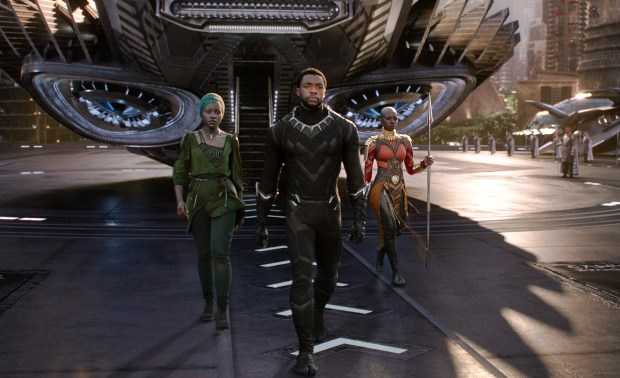 "This image released by Disney shows Lupita Nyong'o, left, and Chadwick Boseman and Danai Gurira in a scene from Marvel Studios' ""Black Panther."" (Matt Kennedy/Marvel Studios-Disney via AP)"