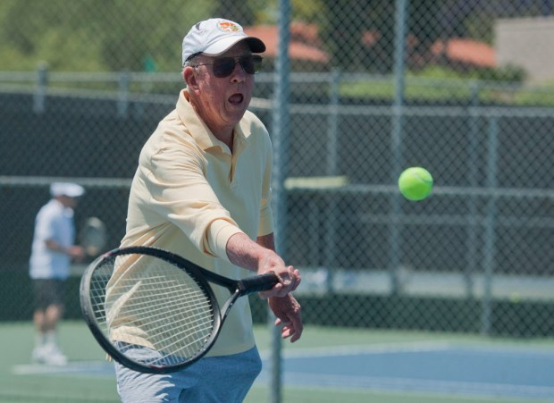 Bill Nyhan of La Jolla competes in the 90-and-over doubles final of the Vern Hughes USTA Hardcourt Senior Championship tennis match in Laguna Woods on Thursday, May 18, 2017.Photo By Jeff Antenore, Contributing Photographer