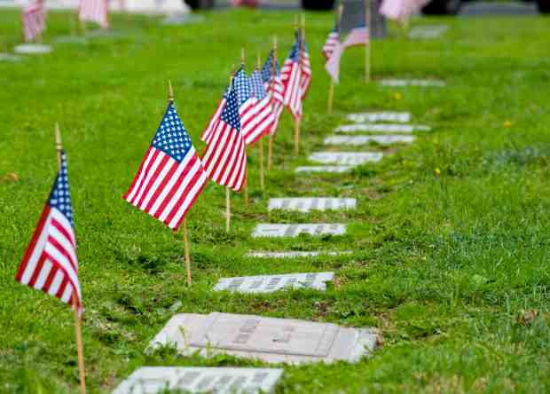 Flags mark the gravesites of veterans for the annual Memorial Day Service at Harbor Lawn-Mt. Olive Memorial Park and Mortuary in Costa Mesa, which is planned again this year. (Register file photo)