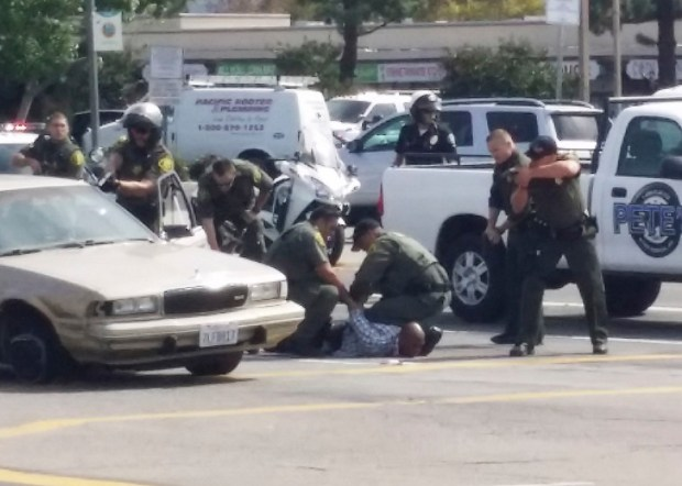 In this file photo, bank robbery suspect Chandler Graham is taken into custody after a pursuit in Tustin September 21, 2015. (File photo)