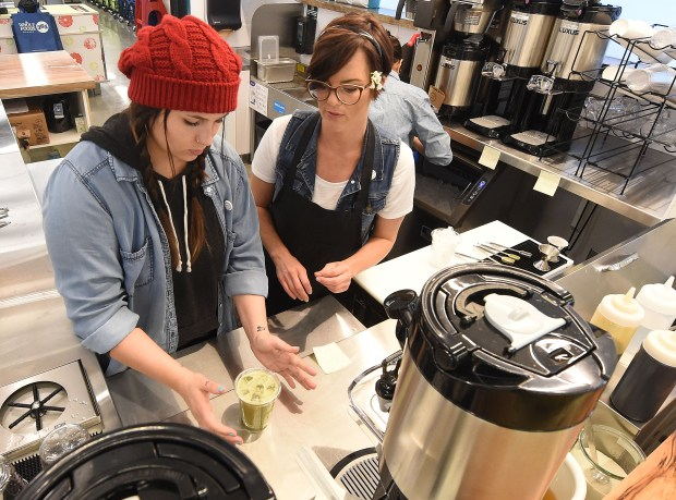 Sam Kessler, (left) 23 from Upland, makes an iced coffee as she is trained by Tina Wiederen Thursday May 24, 2018 at the new Whole Foods 365 store which is set to open May 30 in Sycamore Hills in Upland. The Upland store will be the first 365 by Whole Foods store in the Inland Empire. (Photo by Will Lester, Inland Valley Daily Bulletin/SCNG)