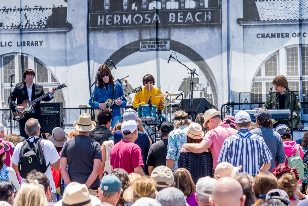 "The Beatles cover band ""Ticket to Ride"" performs at Fiesta Hermosa in Hermosa Beach on Saturday. (Photo: Gil Castro)"