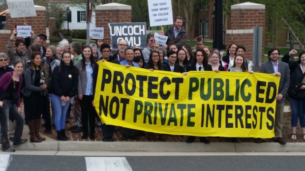 Faculty and students at George Mason University protested against the Charles Koch Foundation outside a Virginia courthouse in April 2018. A campus group affiliated with UnKoch My Campus filed a lawsuit which forced the university to disclose confidential contracts with the Koch foundation. (Courtesy of UnKoch My Campus)