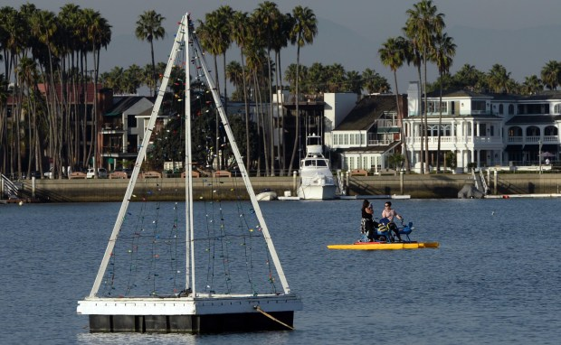 People ride Water Bikes in Alamitos Bay in Long Beach. ( Photo by Stephen Carr, Daily Breeze / SCNG )
