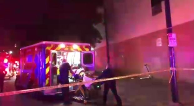 One of five shooting victims is loaded into an ambulance late Monday, May 7, 2018, in downtown San Diego. (Image from AP video via KFMB)