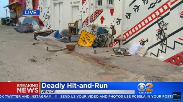The scene near the Venice Boardwalk where a sleeping homeless man was killed in a hit-and-run on April 19, 2018, is seen in this image from CBS2 video.
