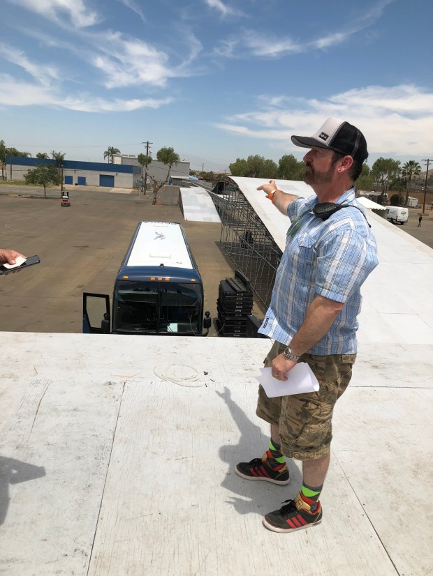 Tes Sewell, technical director for Travis Pastrana's team, talks about a planned jump over 16 Greyhound buses in Las Vegas next month. (Photo by David Downey, Staff)