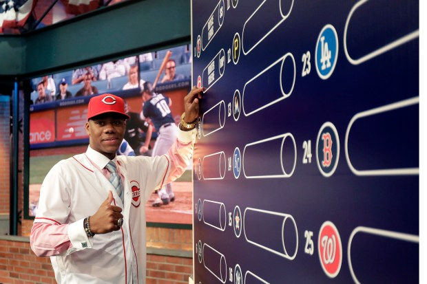 Hunter Greene poses for photographs after putting his name on the board moments after being selected No. 2 overall by the Cincinnati Reds in the 2017 Major League Baseball draft last June in Secaucus, N.J. (AP Photo/Julio Cortez)