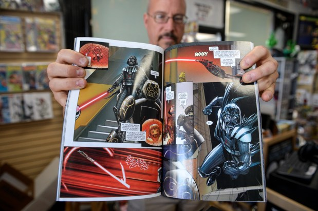 "Warren Jaycox, owner of Galaxy of Comics in Van Nuys, holds one of the new Star Wars comics, which is being launched in conjunction with the release of the latest Star Wars movie, ""Solo: A Star Wars Story"" (Photo by David Crane, Los Angeles Daily News/SCNG)"